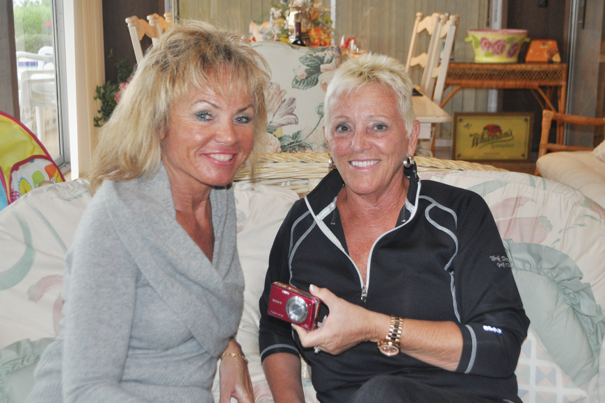 Jody Vitt and Linda Chambers hold the Sony Cybershot camera.