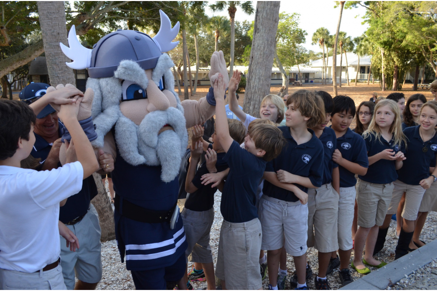 Kids get excited as mascot Thor makes his way to the ribbon cutting.