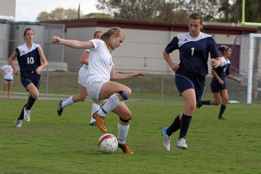 Riverview's Rachel Easterling, No. 5, tries to keep the ball away from North Port's Kelley Mayo, No. 1.
