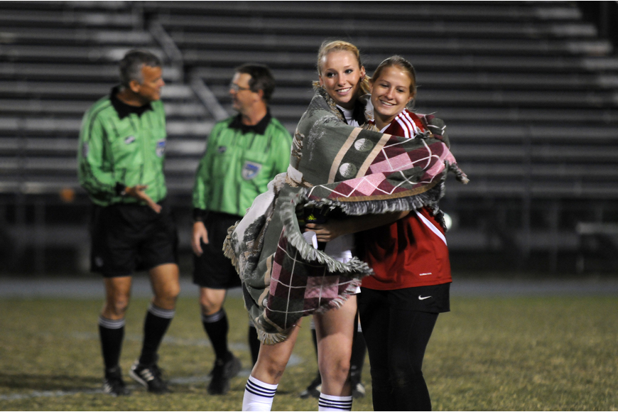Aubrey Riggins celebrates with goalkeeper Alex Latham following the Lady Mustangs 4-1 regional quarterfinal victory over Cape Coral Ida Baker Jan. 23.