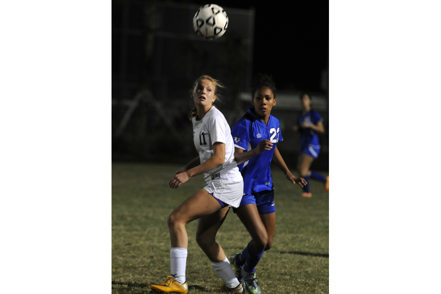 Lakewood Ranch defender Tatum Young attempts to between the ball and an Ida Baker opponent.