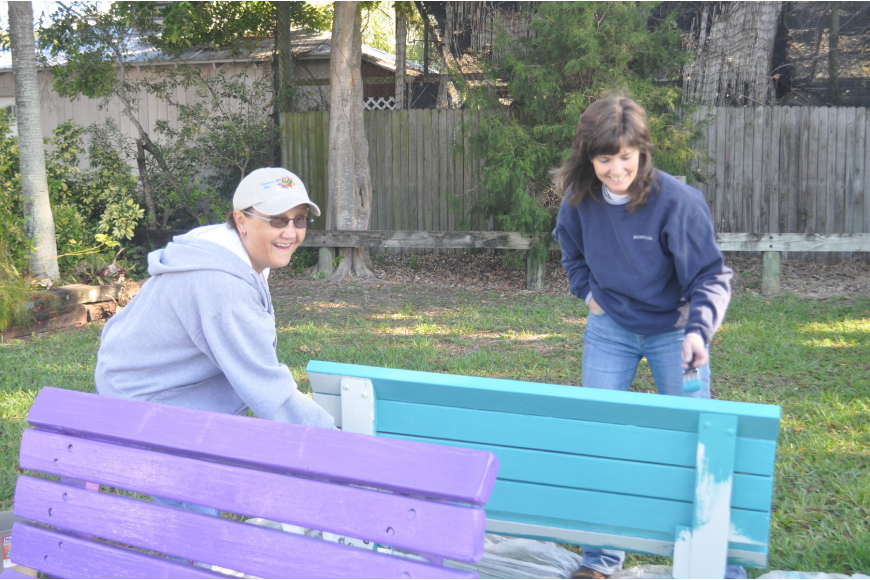Claudia Benz and Sheree Cade paint a bench.