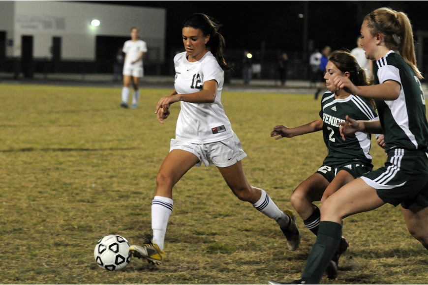 Lakewood Ranch senior Chelsea Martin attempts to clear the ball past a pair of Venice defenders in the Class 4A-Region 3 semifinals Jan. 26.