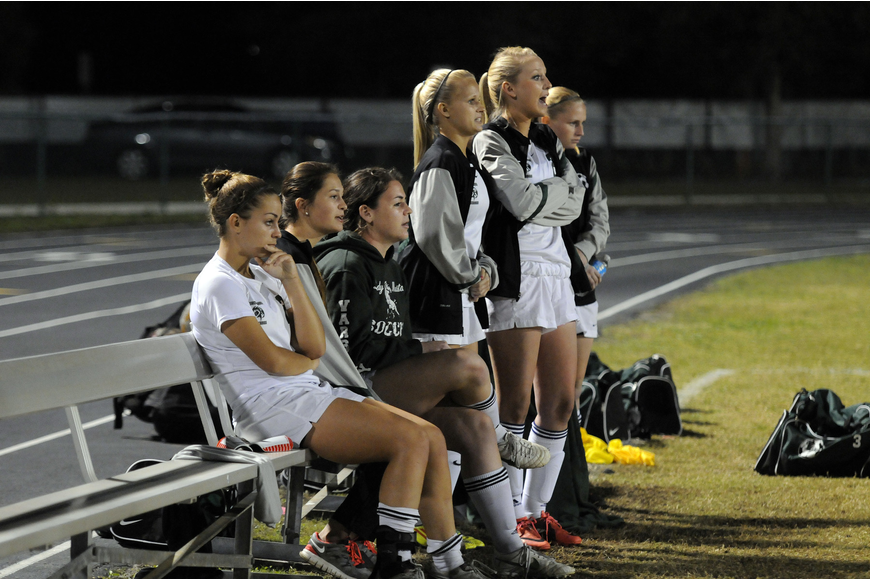 Members of the Lakewood Ranch High girls soccer team look on as their teammates try to keep Venice from scoring in the final two minutes of the regional semifinals.