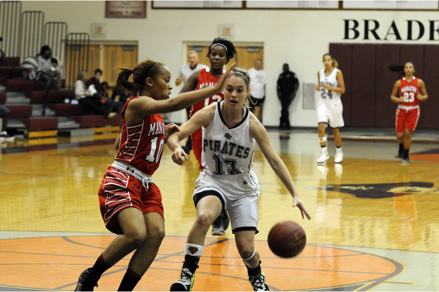 Braden River senior Erica Glisson attempts to dribble past Manatee's Aja Nixon.