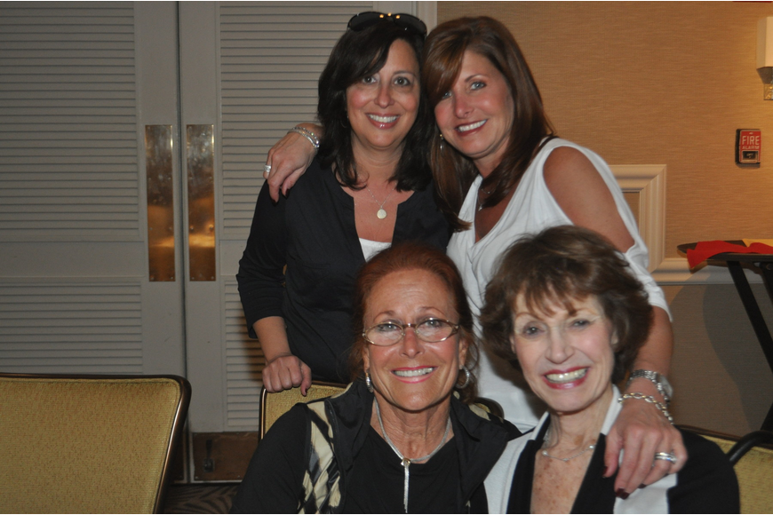 front, Renee Ross, Barbara Vornoff, back, Carrie Goodman and Julie Brown at the Longboat Key Club Super Bowl party