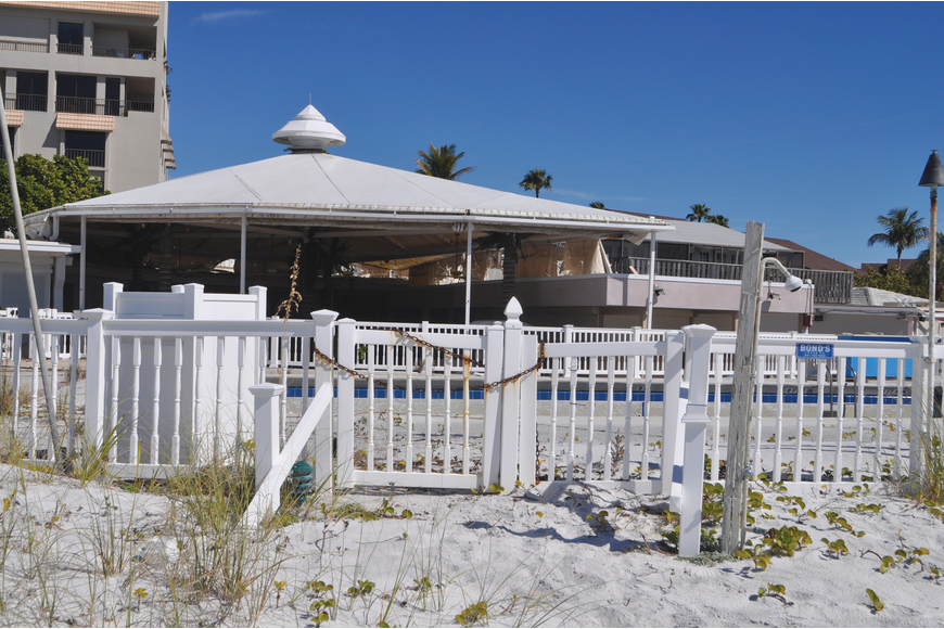 The cabana tent at the pool is tattered and is visible from the beach outside the Colony Beach & Tennis Resort.