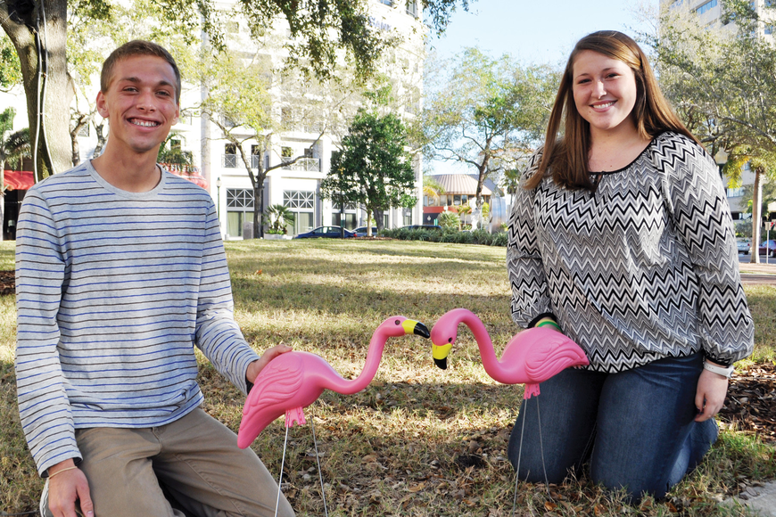 Alyssa Sweeney and Jack Boeve, Relay for Life co-captains, with the lawn flamingos