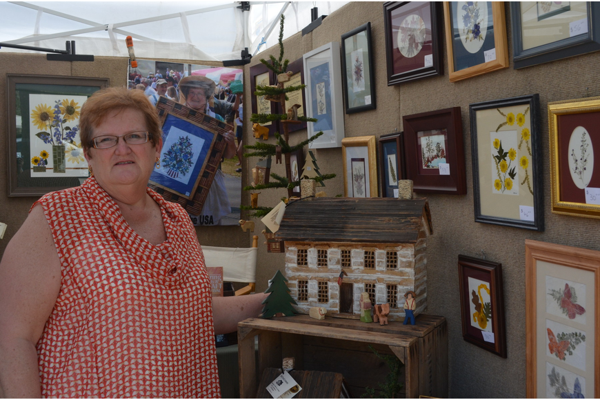 Judy Boyer makes pressed flower pictures and he husband woodwork for the 1860 Wood Company.