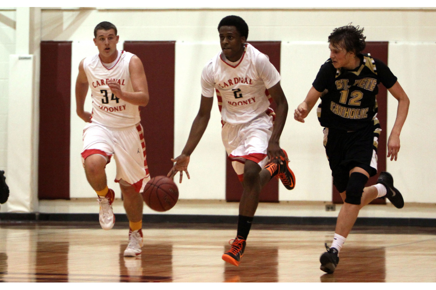 Cardinal Mooney's Antonio Blakeley, No. 2, runs up the court with teammate Mitch Arimura, No. 34, and being followed by St. Petersburg Catholic's Kevin O'Donnell, No. 12.