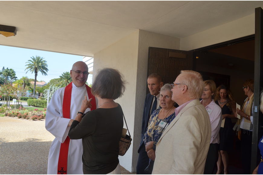 New Rector John C. N. Hall greets parishioners after service.