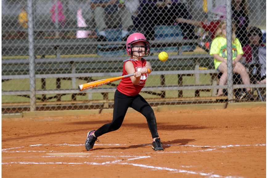 Seven-year-old Erin McIntyre makes contact during her team's season-opener versus Pemco Feb. 23.