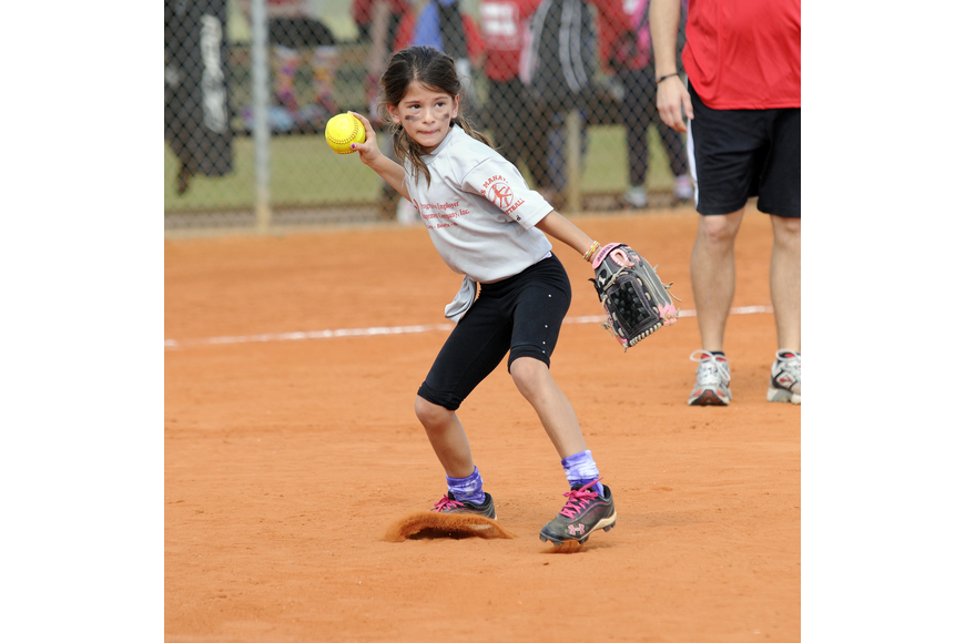 Pemco pitcher Samantha Rees, 8, throws the ball back to first base.