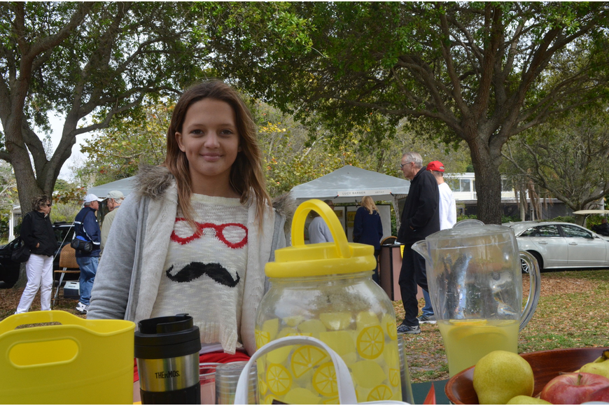 Lindsey Jennings, 11, sells refreshments at the art festival.