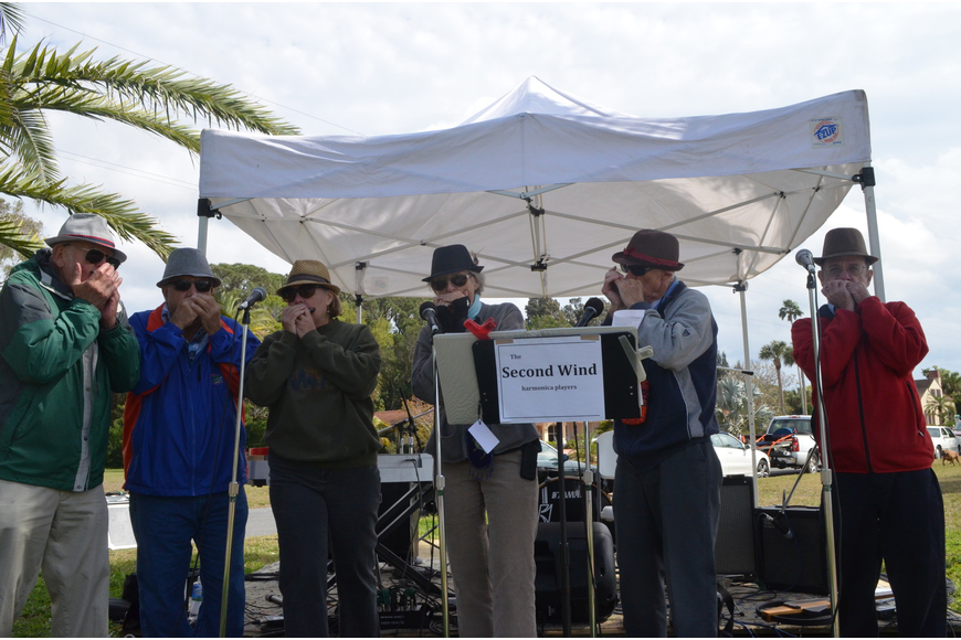 The Second Wind harmonica players performed for festivalgoers.