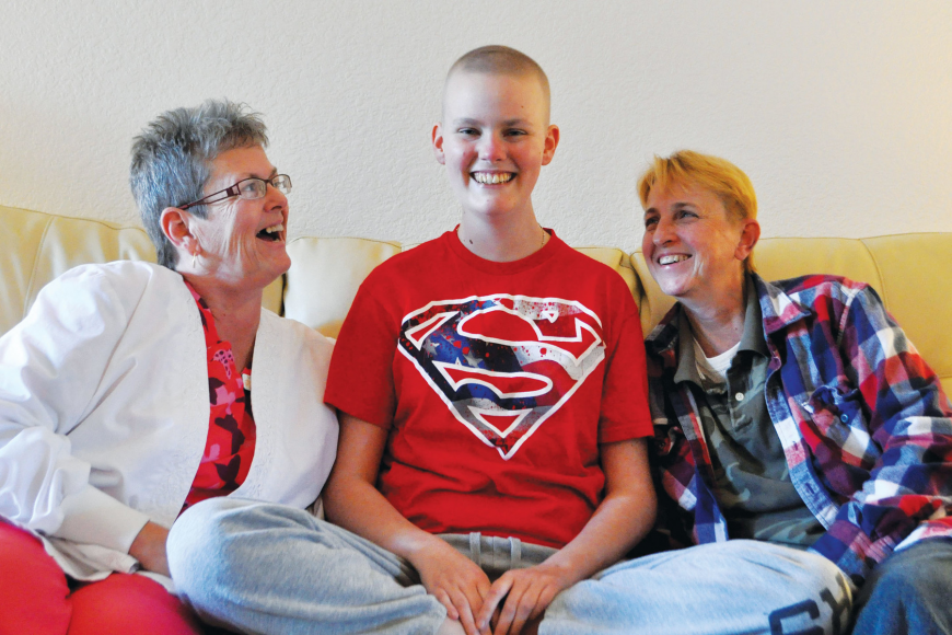 Ashley Krueger sits between her parents, Cindi Krueger and Pat Myers. Ashley Krueger is fighting T-cell lymphoma and is awaiting a bone marrow transplant. Photo by Nick Friedman