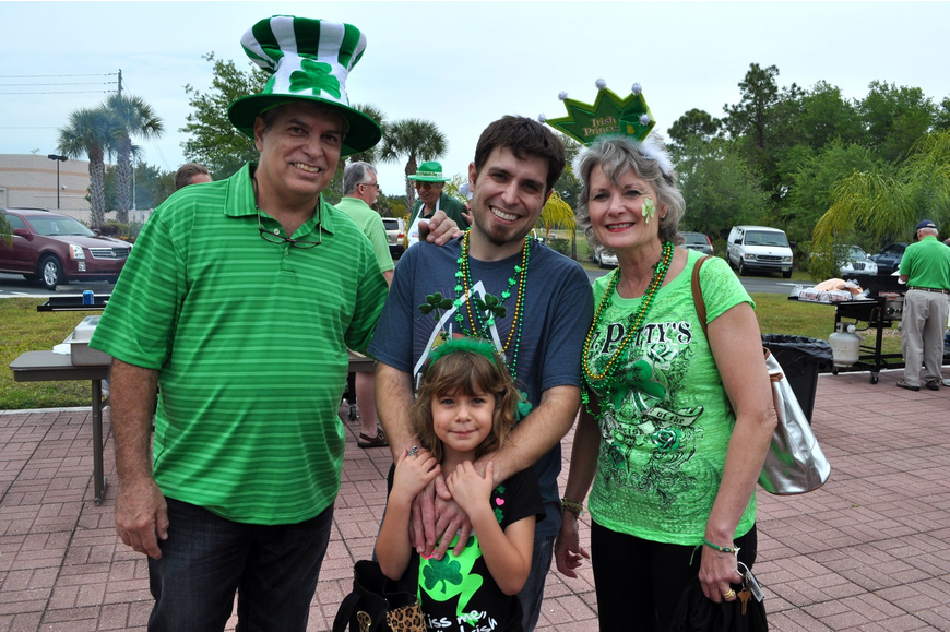 Rick Marot along with his son Dan, granddaughter Ava, 7, and wife Charlene all got into the spirit of the party with beads, hats, headbands and crowns.