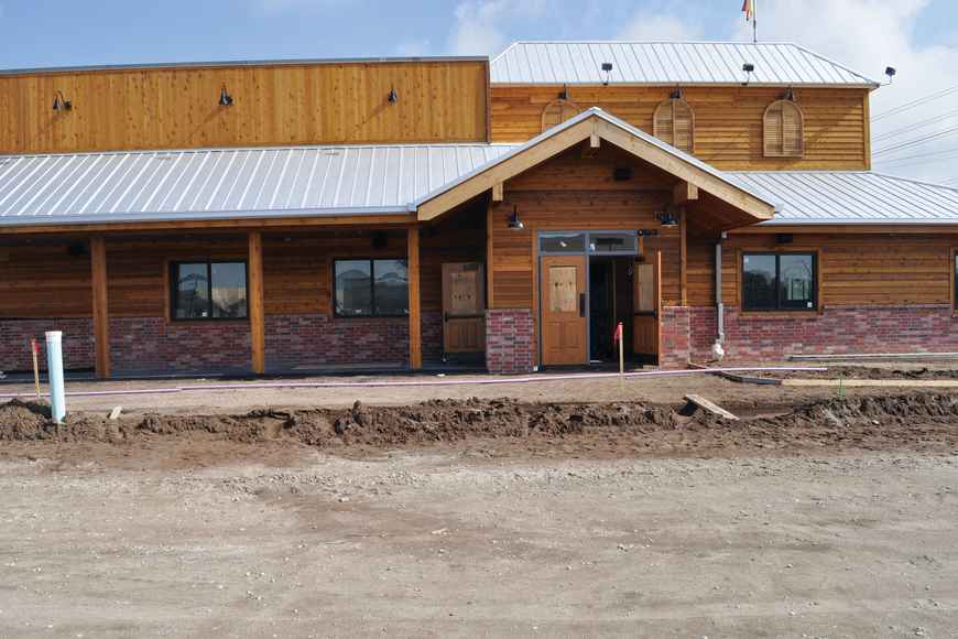 Texas Roadhouse restaurant will occupy one of the five stand-alone buildings at River Club Plaza on State Road 70.