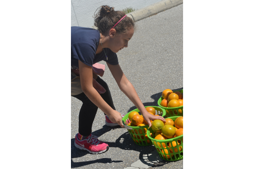 Fifth grader Katie Beal drops of an orange during the relay race at the Browns Grove Zone.