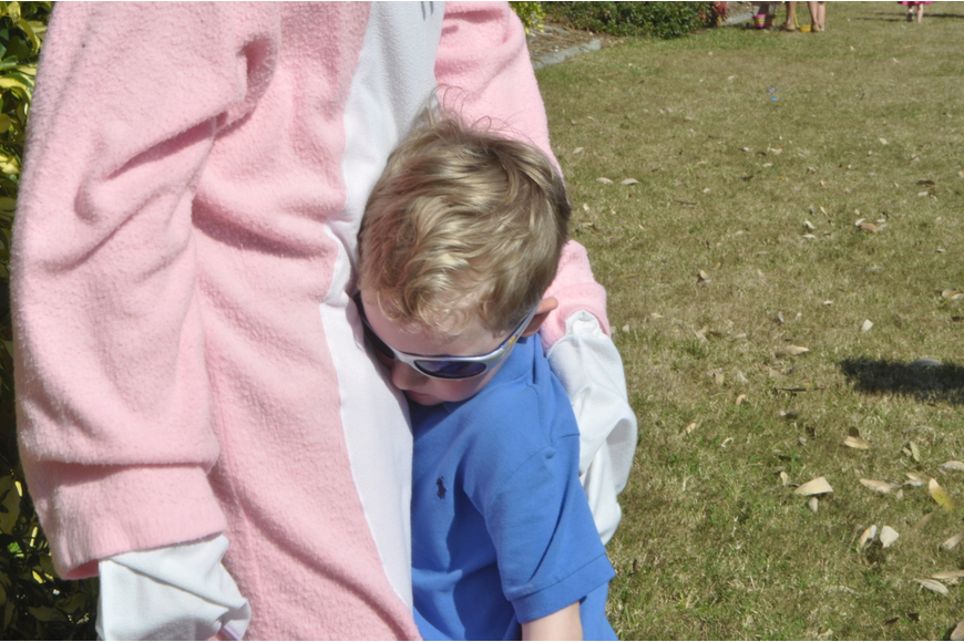 Charlie Cary, 4, hugs the Easter Bunny.