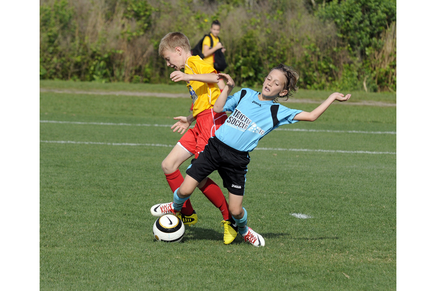 Strictly Soccer's Nikola Sljivic, 11, battles a Lakewood Ranch Chargers defender for the ball.