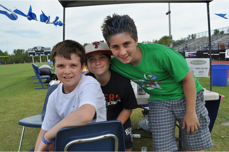 Out-of-Door sixth graders Anthony Squitieri, Max Hajduk and Ethan Marino, who sold glow sticks at the race.