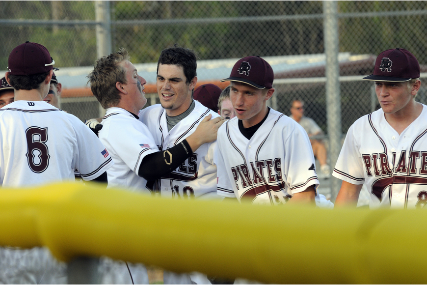 Braden River senior Dylan Lee, center, is congratulated following his solo home run in the bottom of the first inning.