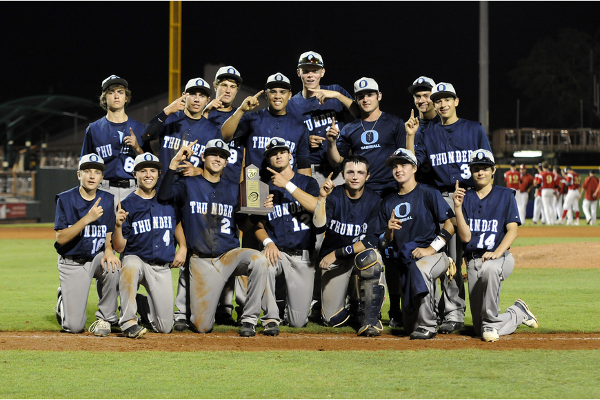 The Out-of-Door Academy baseball team celebrates its second district championship in three years after defeating Cardinal Mooney 11-3 in the Class 3A-District 10 championship April 26.