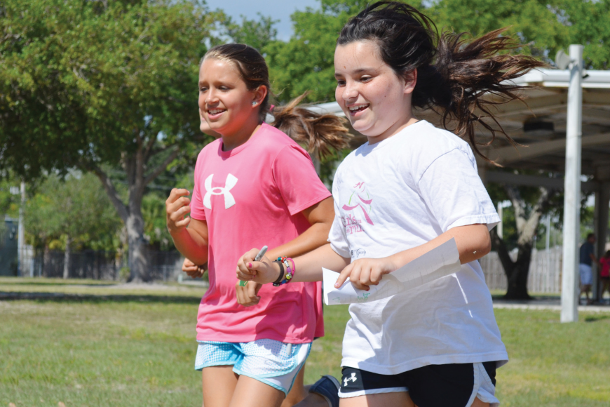 Lilly Dougherty, right, runs the track with a friend at Phillippi Shores Elementary School in preparation for the upcoming Girls on the Run 5K Saturday, May 4, at Nathan Benderson Park.