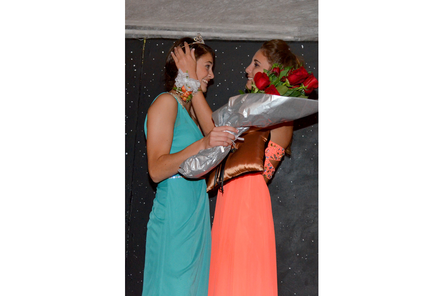 Paige Troyer crowns Nicole Wittmer queen.