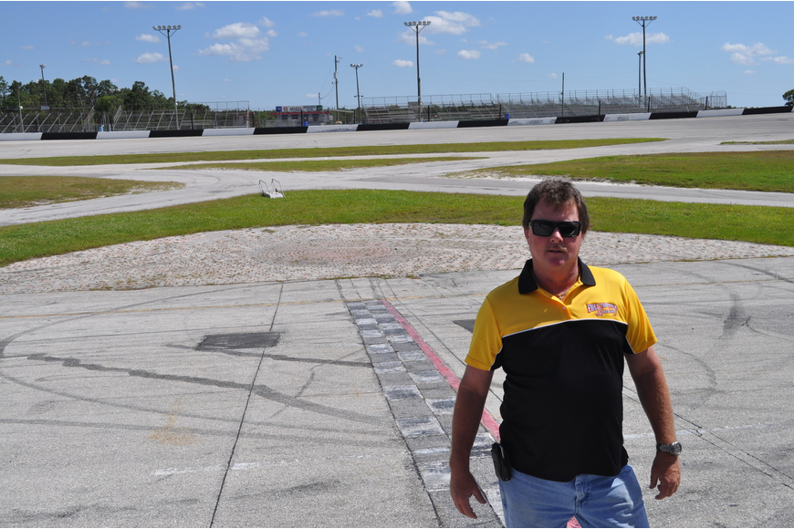 Kevin Williams, one of the new owners of Desoto Speedway, now Full Throttle Speedway, stands on the freshly renovated track, which has 18-degree banked turns primed for fast driving. The new racing season started May 4.