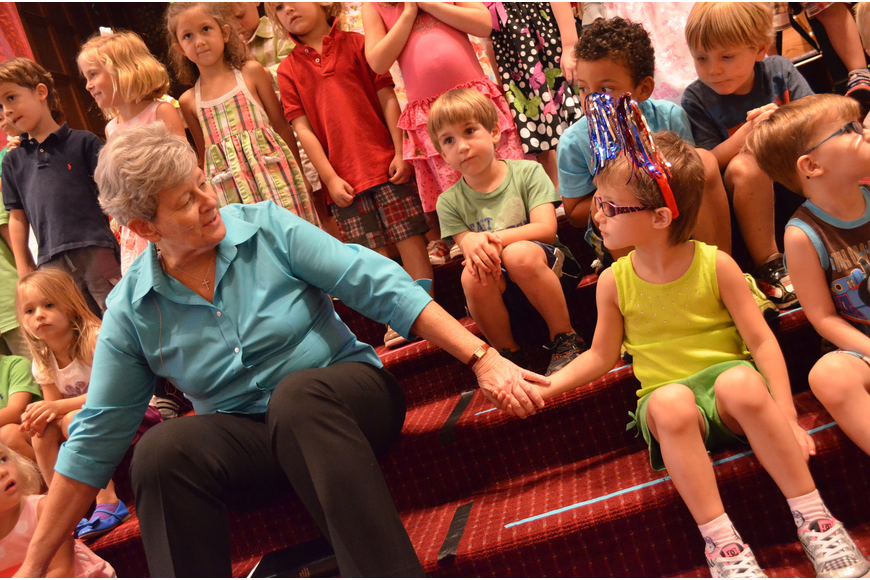 Pastor Kathy Dain holds Isabelle Faucher's hand and thanks God for the wonderful children.