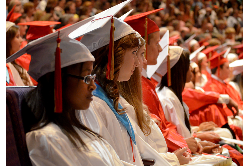 Students listen to the commencement speech.