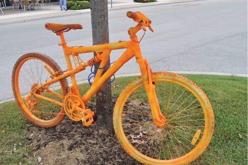 This bike is one of 13 spray-painted bikes locked up at shopping centers along University Parkway.