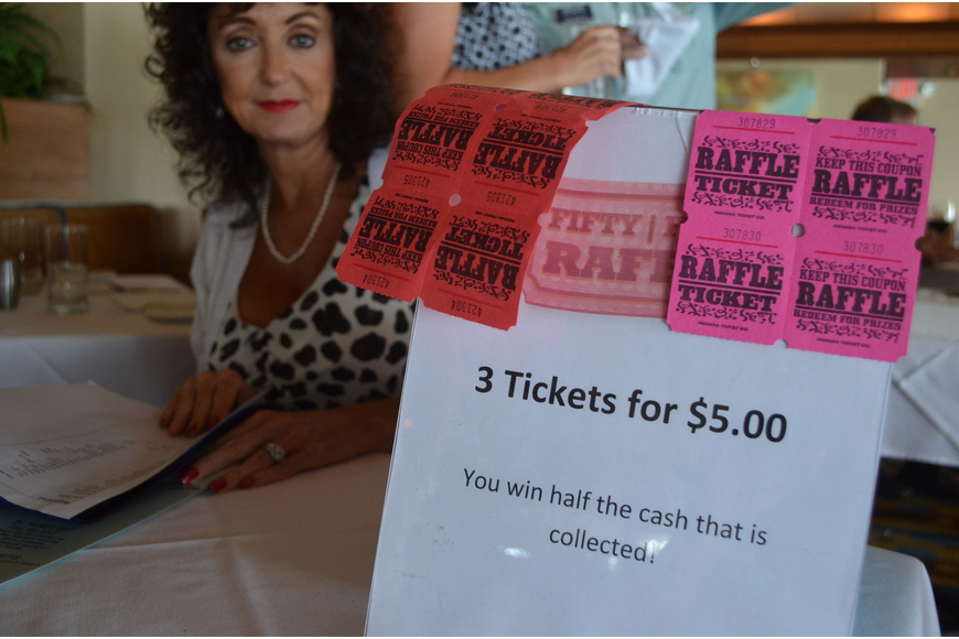 Executive Assistant of the Longboat Chamber of Commerce Victoria Jacobson sold raffle tickets.