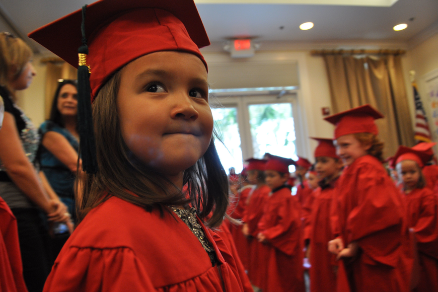 Elia Shen, of Primrose, looks for her parents as she marches into the room.