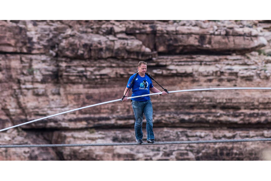 Nik Wallenda made history Sunday, June 23, when he walked a 2-inch-wide cable suspended 1,400 feet above the Grand Canyon's Little Colorado River Gorge. 