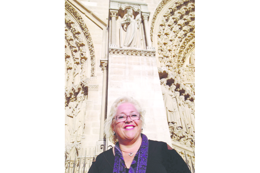 Julie Aranibar stands outside the Notre Dame Cathedral, in Paris.