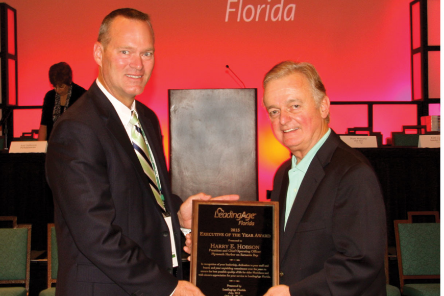 George Bryan, vice chair of the Central Florida Region of LeadingAge Florida, with Plymouth Harbor CEO Harry Hobson. Courtesy photo.