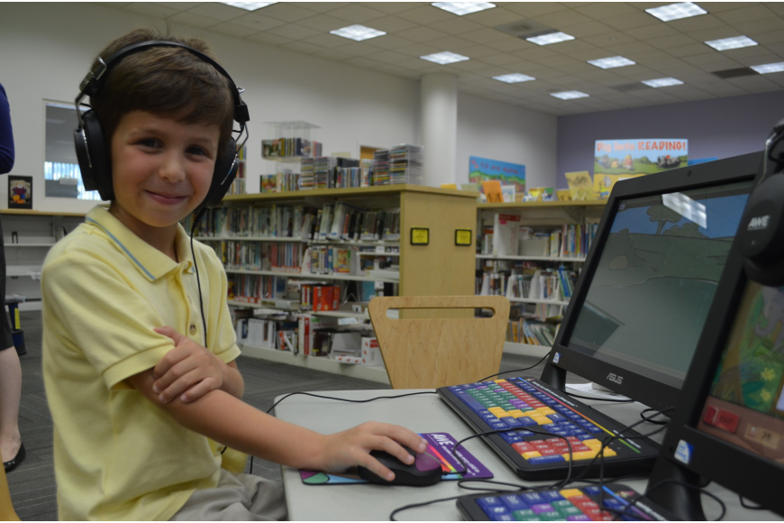 Gianluca Mastroianni, 5, loves to play on the AWE Early Literacy Learning Station. He demonstrates the games he plays to library staff and board members.
