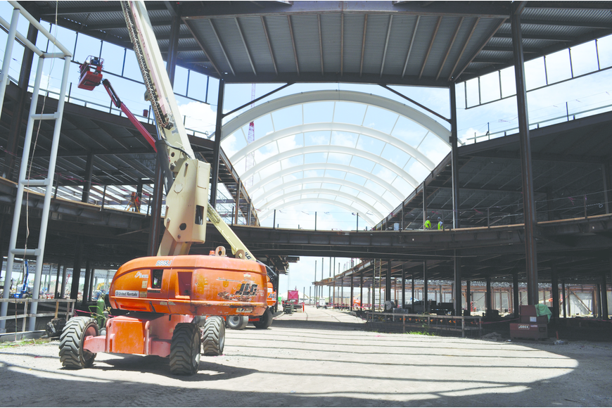 Construction crews are working on the mall's concourse area. Shops will line both sides of the two-level building.