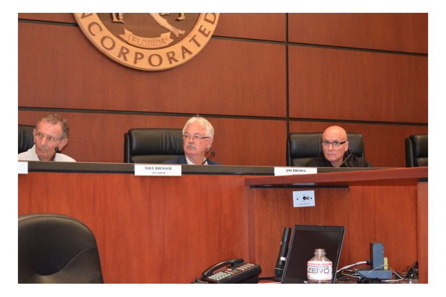 Mayor Jim Brown, center, cast the deciding vote Monday that approved two additional retirement incentives for general employees before their pension plan is frozen next month.