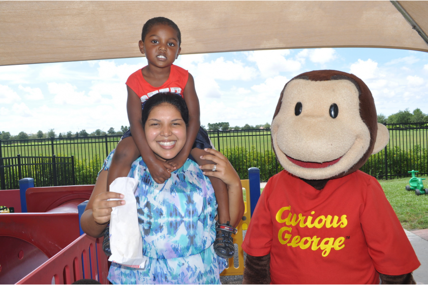 Jenelle and Xavier Omatseye hung out with Curious George.