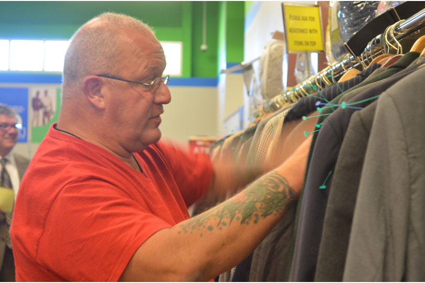 Navy veteran Steve Pitt looks for a suit to wear to job interviews. He uses the resources Goodwill provides to find a job as a licensed practical nurse.