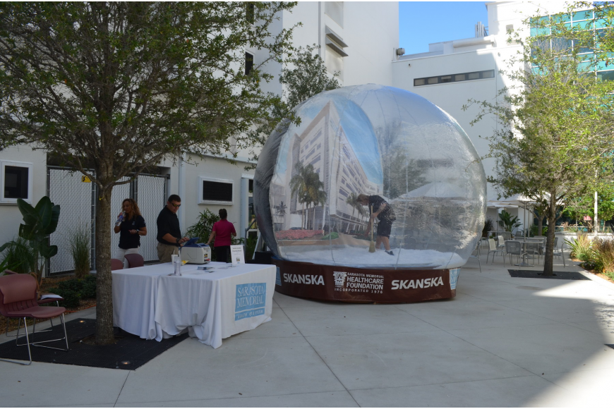 Community members are encouraged to visit the new SMH courtyard tomorrow and have their photograph taken for free in the inflatable snow globe.