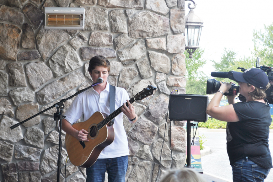 Sam Woolf, a Braden River High School student, performed Friday, Sept. 6, at MacAllisters on Lakewood Ranch Main Street. Photo by Harriet Sokmensuer.
