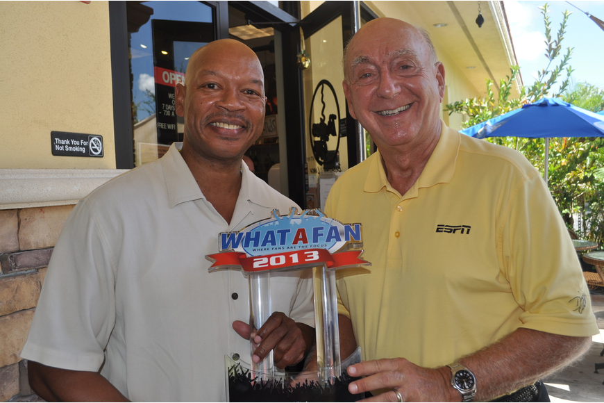 Lowell Moore of What A Fan traveled from Orlando to present Dick Vitale with the first-annual Sports Icon Award at The Broken Egg Friday.