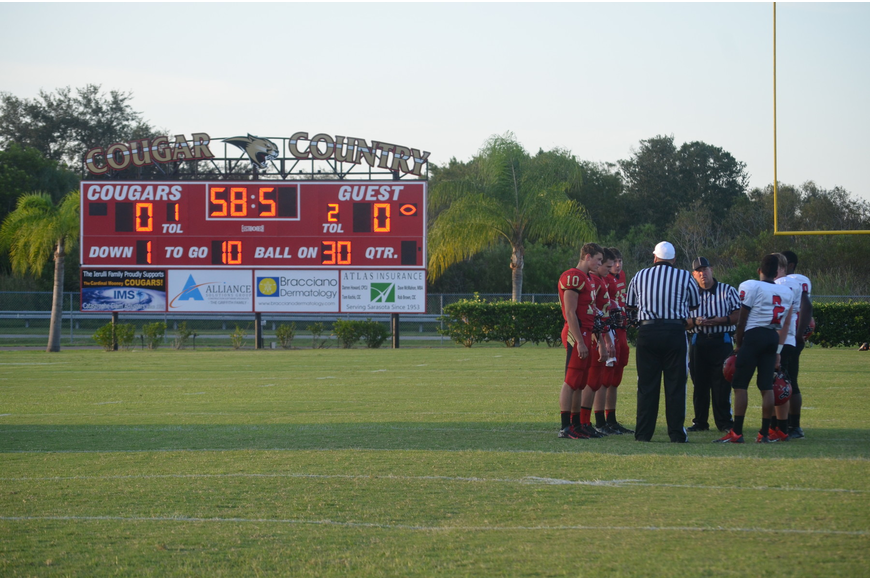 Cardinal Mooney won the coin toss and chose to receive.