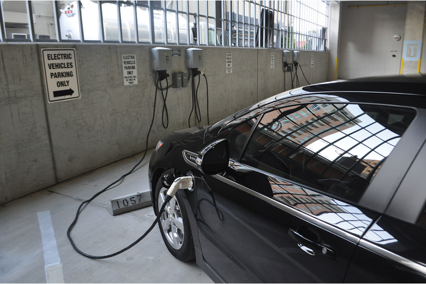 Chris Sharek's Chevrolet Volt charges for free at the Palm Avenue parking garage.