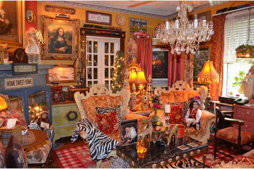 Years of collecting fill the Zurich-Wus living room with sparkle and splendor. The Greek doll in the rococo chair is by Tampa artist Fayzah Spanos and the chandelier is a Craigslist find.